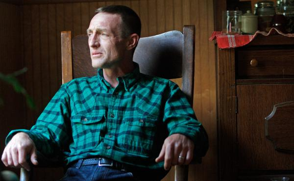 """""""Some days I wake up and go, 'Am I wasting time, when I could be on chemotherapy or getting a surgery?' """" asks Tony Lapinski, a Montana veteran who worries about what is causing his back pain."""