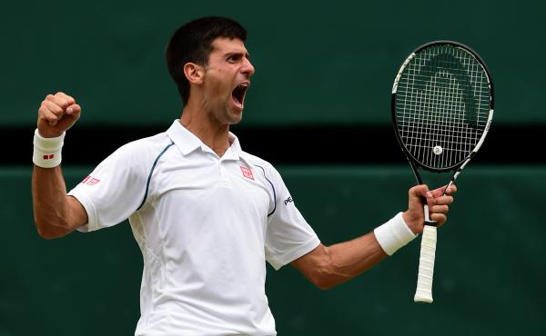 Novak Djokovic celebrates his win over Roger Federer in the men's singles final at Wimbledon.