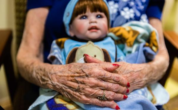 Vivian Guzofsky, 88, holds a baby doll at Sunrise Senior Living in Beverly Hills, Calif. Guzofsky, who has Alzheimer's disease, is calm when taking care of the dolls.