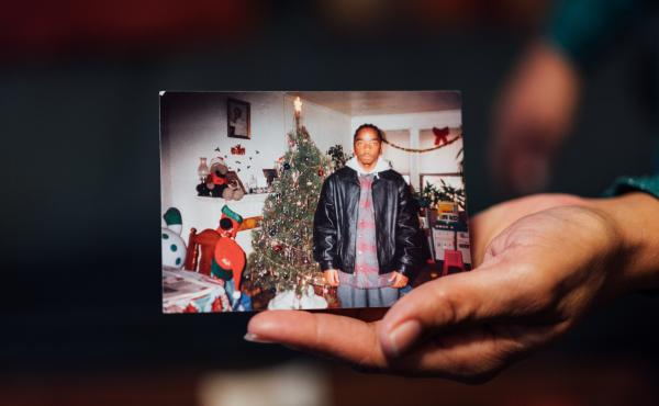 One of the last family photos of Bernard Simmons is shown by his sister, Debra Simmons, in her home in Chicago.