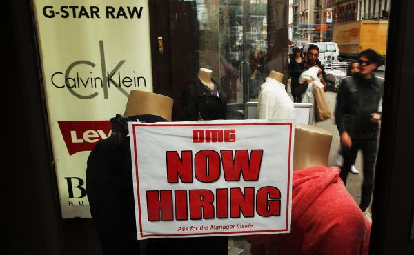 A notice in a store window in New York City announces a retail job opening. Now that unemployment has slipped below 6 percent, there's renewed interest in what the Federal Reserve's target for joblessness should be.