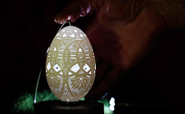 A picture taken on April 22, 2011, shows a special Easter eggshell decorated with more than 20,000 holes by Franc Grom, an artist based in the Slovenian village of Stara Vrhnika. Using a tiny electric drill, Grom pokes thousands of holes in eggshells to c