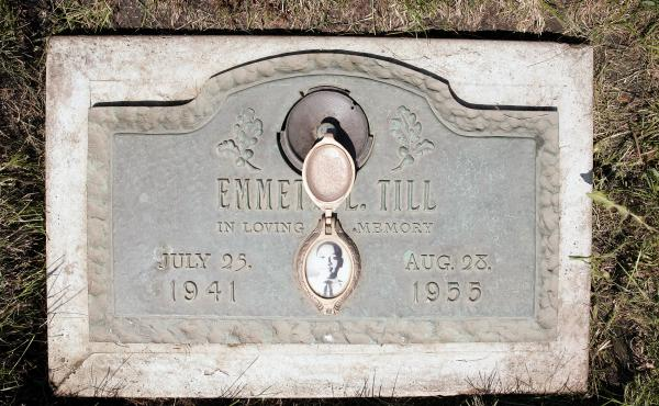 A plaque marks the grave site of Emmett Till at Burr Oak Cemetery in Alsip, Ill. Till died in a lynching in Mississippi in 1955. A decade prior, his father, Louis Till, was hanged after being convicted of rape and murder, but writer John Edgar Wideman bel