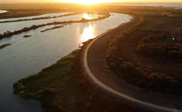 The sun sets over the Sacramento-San Joaquin River Delta near Rio Vista, Calif., in 2013. The delta is the largest West Coast estuary and a source of conflict over the state's water.