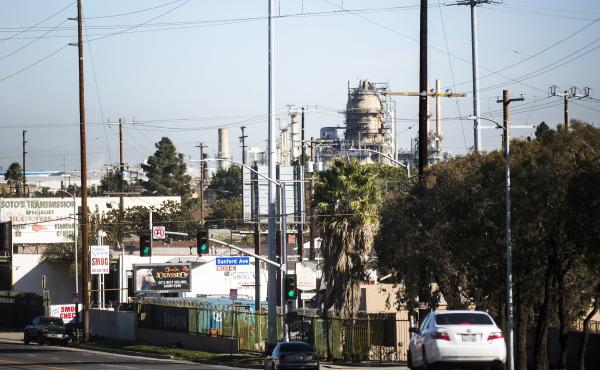 Some environmental justice advocates say California's cap-and-trade program hasn't done anything to clean up the air in low-income communities like Wilmington, where refineries are located near residential neighborhoods.