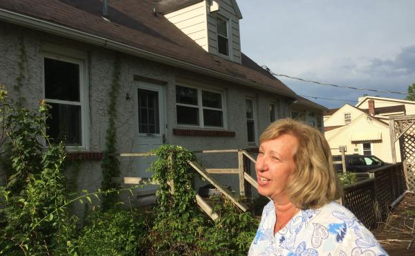 "The house next door to Maureen and Michael McCabe has been sitting empty for seven years. ""It freaks me out,"" Maureen McCabe says. ""I don't know if there's animals running around there, mice and rodents."""