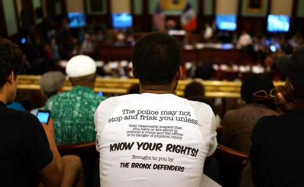 A critic of the New York City Police Department stop-and-frisk policy wears a shirt outlining a citizen's search rights at a city council meeting in August 2013. The Supreme Court ruled Monday in an unrelated case that even if police stop someone without