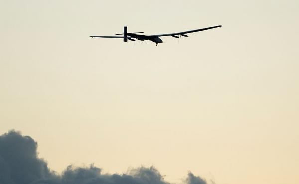 The Solar Impulse 2 airplane, piloted by Bertrand Piccard, gains altitude after taking off from Kalaeloa Airport in Kapolei, Hawaii during a test and training flight in April.