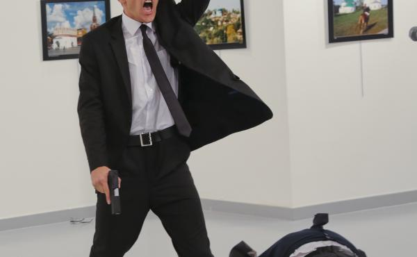 World Press Photo awarded its top honor to Burhan Ozbilici's image of a man with a gun standing over the slain Russian ambassador in Ankara in December.