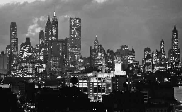 A photo taken from the Brooklyn Bridge shows the Manhattan skyline, circa 1955.