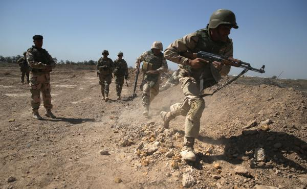 Army trainers conduct drills at a military base in Taji, Iraq last year.