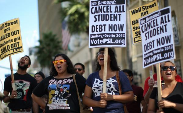 Students protest the rising costs of college loans in Los Angeles in 2012. Citing bank bailouts, the protesters called for student debt cancellations.