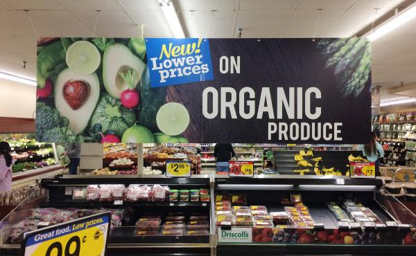 "Produce is often accompanied by signs like this one at a King Soopers grocery store in Fort Collins, Colo. But customers are often confused by their meaning, which is one reason the Organic Trade Association is trying to raise money for a ""checkoff"" to pa"