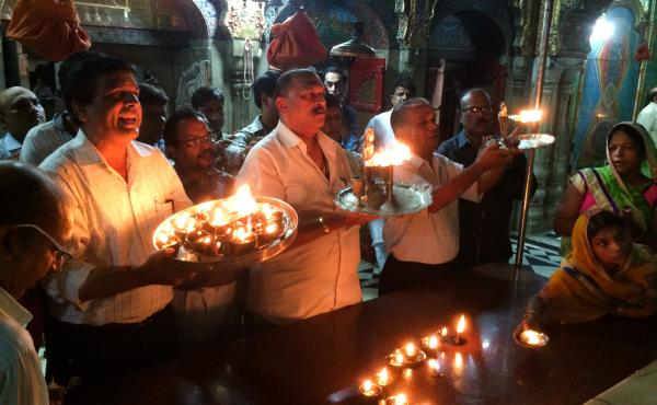 On Friday nights in their Delhi sanctuary, Jains light candles to pay tribute to their 24 gods.