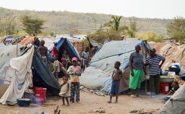 Children play among the tents of Parc Cadeau, one of the camps set up in Haiti for migrants who've left the Dominican Republic after being stripped of their citizenship.