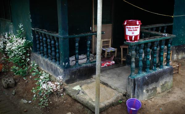 The home of Marthalene Williams, the Ebola-stricken woman aided by Thomas Eric Duncan. A man on the porch, who appeared to be in the late stages of Ebola, informed our photographer that he'd been to a hospital but was told to return home and quarantine hi