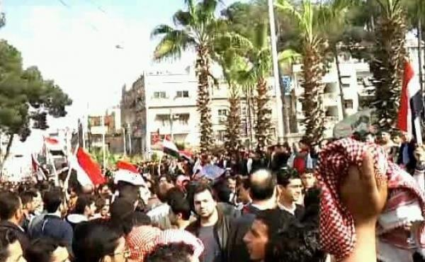 Syrian Aram al-Doumani (center, facing camera) takes part in a peaceful protest against Syrian President Bashar Assad in Douma, Syria, in 2011. Doumani, who now runs an opposition news agency in Syria, says he is skeptical of a breakthrough in cease-fire