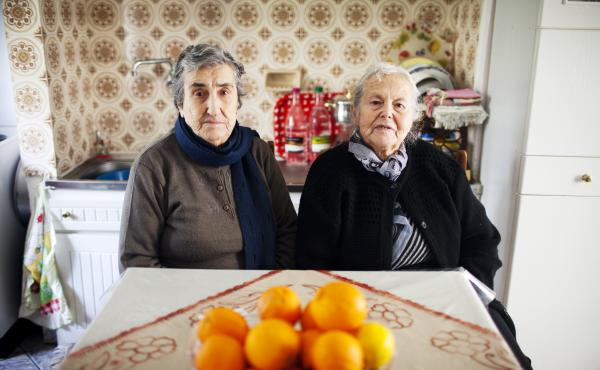 "The mothers of Militsa Kamvysi, 83, (left) and Maritsa Mavrapidou, 85, arrived on the Greek island of Lesbos nearly a century ago as refugees from what was then the Ottoman Empire (now Turkey). ""We welcomed refugees because we're descended from refugees,"