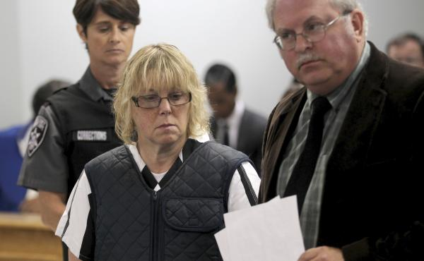 Joyce Mitchell, who has reached a plea deal over charges that she aided a prison escape, is seen here during a June court date, along with her lawyer, Steven Johnston.