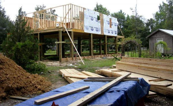 Ten years ago, Hurricane Katrina made landfall near Pearlington, Miss., a tiny town on the border with Louisiana. A home currently under construction there adheres to new FEMA standards for elevation.
