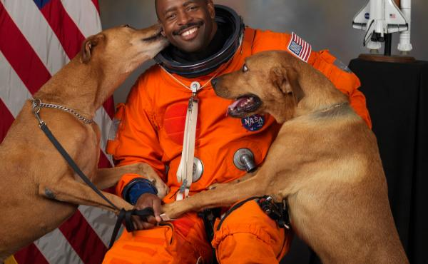 """Leland Melvin with his dogs, Jake and Scout. """"I snuck them into NASA to get this picture,"""" Melvin says."""