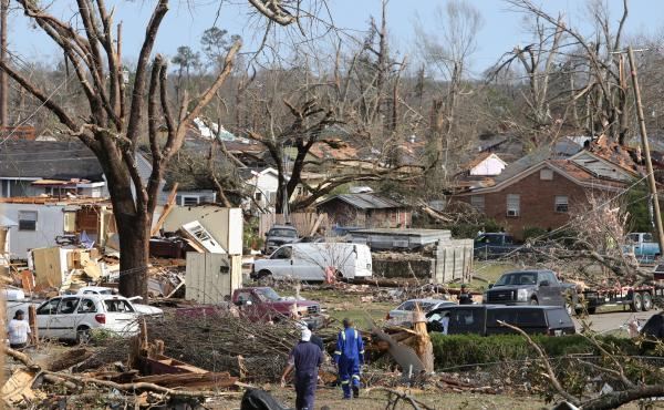 Damaged trees and homes are scattered along Magnolia Street in Hattiesburg, Miss., after a tornado struck on Saturday. Four people died in the storm.