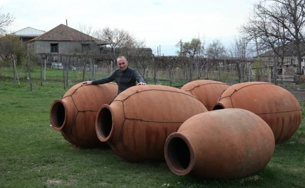 Winemaker Iago Bitarishvili makes wine in clay vessels called qvevri, which he buries underground and fills with white grapes. There are no barrels, vats or monitoring systems for this ancient Georgian method, which is helping drive sales. Bitarishvili pl