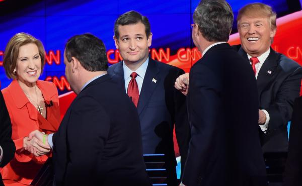 Republican presidential candidates (L-R) Carly Fiorna, Chris Christie, Ted Cruz, Jeb Bush and Donald Trump (R) interact on stage at the end of the Republican Presidential Debate on Dec. 15, 2015.