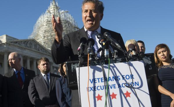 U.S. Rep. Juan Vargas, D-Calif., speaks Wednesday as U.S. military veterans, service members and immigration reform advocates look on during a press conference urging President Obama to move forward with immigration reform at the U.S. Capitol in Washingto