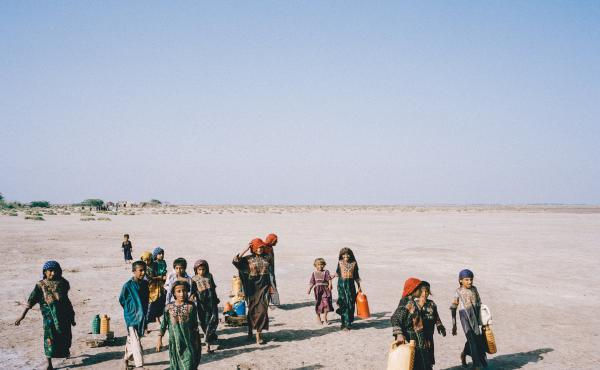 Children of fishermen in Pakistan's Sindh Province travel across the desert for two hours to fetch water.
