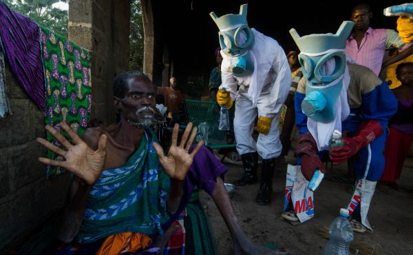 "The photographer brings a surreal touch to the epidemic that struck West Africa in photos titled ""Le Temps Ebola."" The suits worn by the people portraying health professionals evoke carnival masks and animal masks. The question the photographer ponders: """