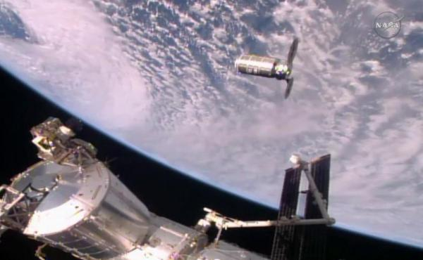 The Cygnus resupply craft slowly approaches the International Space Station — and its waiting robotic arm, the Canadarm2 — Sunday morning.