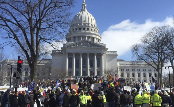 Hundreds of union members rally outside the Capitol in Madison on Tuesday to oppose a Republican-led measure that would make Wisconsin a right-to-work state.