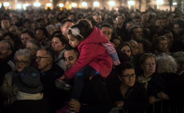 People gather outside of Notre Dame Cathedral in Paris, ahead of a ceremony for the victims of Friday's terrorist attacks. Even as we mourn for those lost in the violence, NPR's Michel Martin says, we should not forget the many who have died in similar at