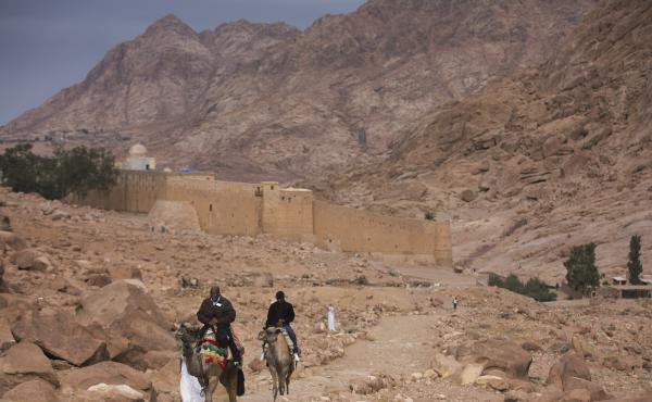 In a 2013 photo, visitors leave St. Catherine's Monastery, a major religious tourism site in southern Sinai. Gunmen attacked a checkpoint near the monastery Tuesday, killing one security officer and wounding four.