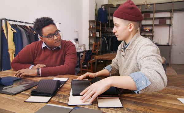 Law student Everett consults with Rae Tutera on his suit for job interviews in HBO's new documentary, Suited.
