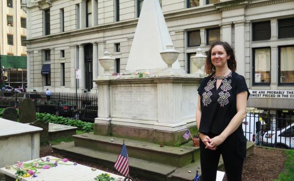 Trinity Church archivist Anne Petrimoulx stands in front of Alexander Hamilton's grave in New York City. The site has seen a surge in visitors following the popular Broadway musical, Hamilton.