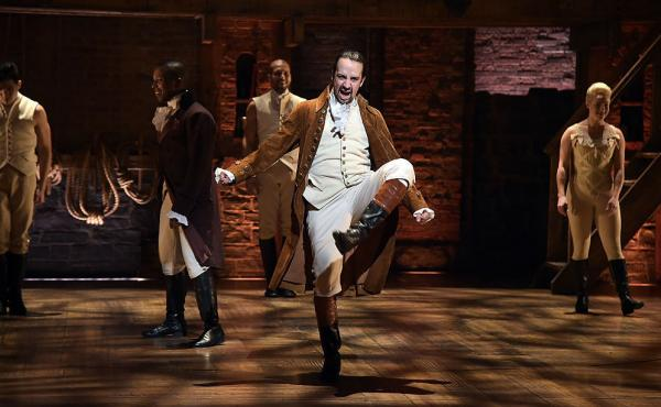Actor and composer Lin-Manuel Miranda (center) performs on stage during a rehearsal of Hamilton ahead of the Grammy Awards in February in New York City.