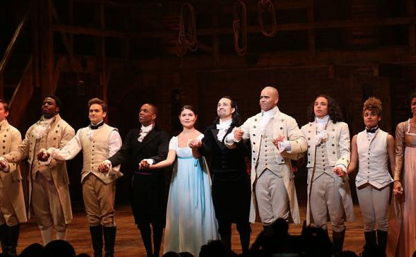 """Leslie Odom Jr., Phillipa Soo and Ariana DeBose with Lin-Manuel Miranda with the cast during their final performance curtain call of """"Hamilton"""" in July."""