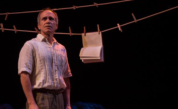 """Actor Henry Godinez as the philosophy professor Oscar Amalfitano, in """"Part II: The Part About Amalfitano,"""" from the Goodman Theatre's lengthy production of 2666."""