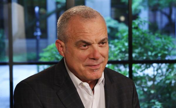 Aetna announced one of its largest pay hikes recently. CEO Mark Bertolini says he believes it largely could pay for itself by making workers more productive.