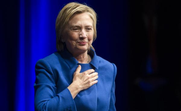 Hillary Clinton walks to the podium to address the Children's Defense Fund in Washington on Wednesday.