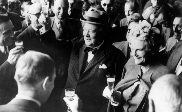 British politician Winston Churchill and his wife, Clementine, make a toast upon their arrival in Switzerland in August 1946. Stories of Churchill's special relationship with alcohol are legendary — and champagne was his truest passion. A new book revea