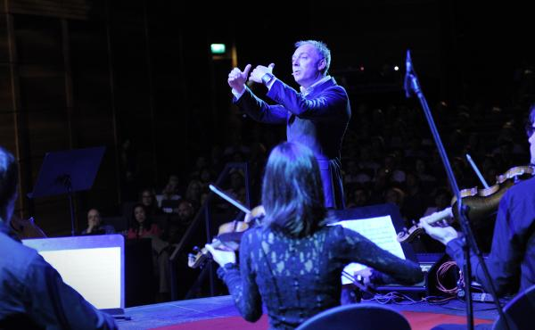 Charles Hazlewood conducting an ensemble at TED.
