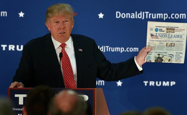 Republican presidential candidate Donald Trump frequently held up newspapers while on the campaign trail.