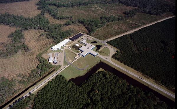 The Laser Interferometer Gravity-Wave Observatory looks for tiny changes in the length of the structure's 2.5-mile-long arms. There are two detectors: one in Washington and one in Louisiana (pictured). This photo was taken before severe flooding that has