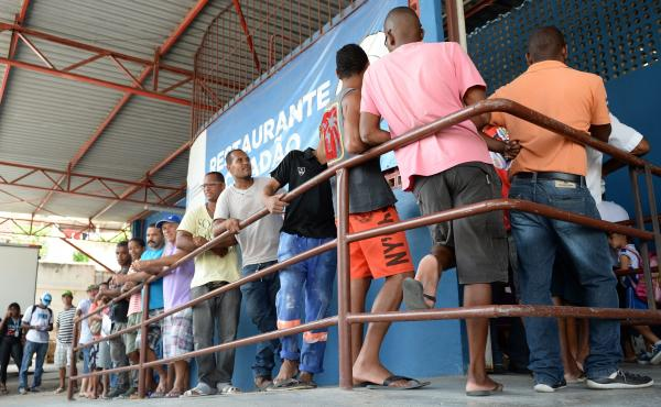 People, most of them unemployed, line up March 19 at a popular Itaborai, Brazil, restaurant where they can have lunch for about 30 cents. The Petrobras refinery and processing plant on the outskirts of town has been shut down; tens of thousands are now ou