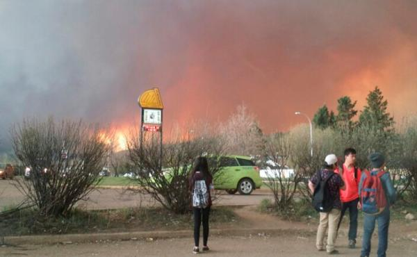 Students from Fort McMurray Composite High School are released early as wildfire burns nearby in Fort McMurray, Alberta, Canada on Tuesday. An uncontrolled wildfire burning near Fort McMurray in northern Alberta, the heart of Canada's oil sands region, ha