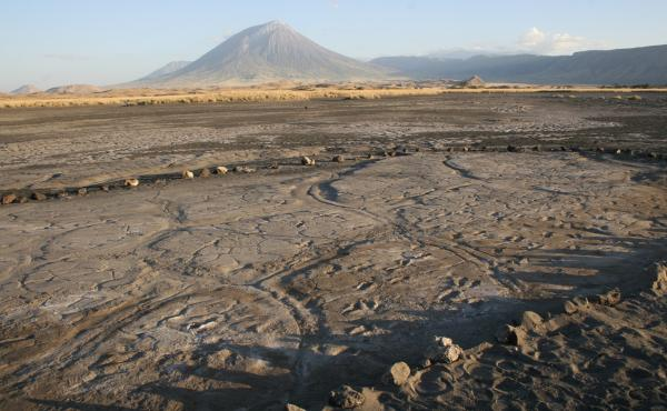 The footprint surface is in the foreground, and we are looking at Oldoinyo L'engai in the background