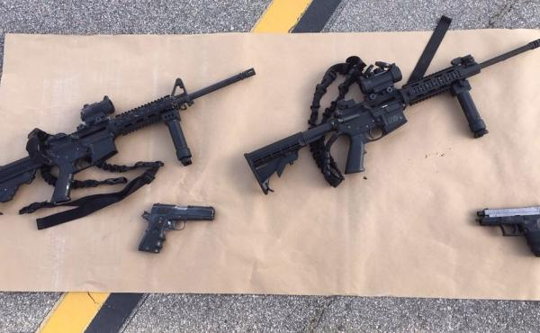 A photo provided from the San Bernardino County Sheriff's Department shows four guns near the scene of a shootout in which Tashfeen Malik and Syed Rizwan Farook were killed. The deadly attack the pair carried out has prompted new calls for tighter gun con